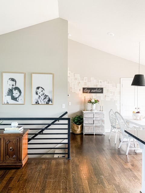 Neutral dining room with metal stair case