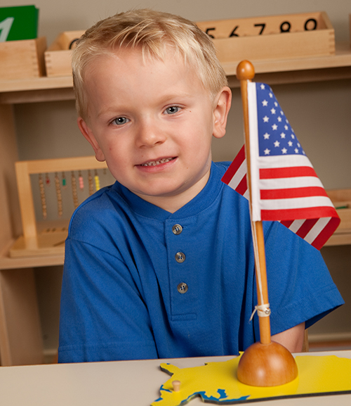 namc montessori fourth of july us flag building and counting boy with flag