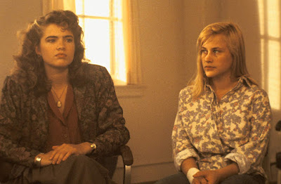 "Nancy Thompson (Heather Langenkamp) and Kristen Parker (Patricia Arquette) talk during group therapy in a movie still for the film ""A Nightmare on Elm Street 3: Dream Warriors"""