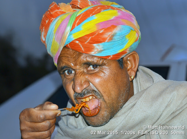 Matt Hahnewald; Facing the World; Asia; people; noodles; night; street portrait; closeup; eating; food; travel; travel destination; India; Rajasthan; Jaisalmer; turban; Indian man; fork; South Asia; fried noodles; Nikon DSLR D3100; 50 mm prime lens