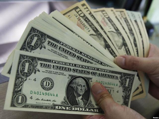 سعر  الدولار يقفز ببنك فيصل الإسلامى الى 19.75 جنيه