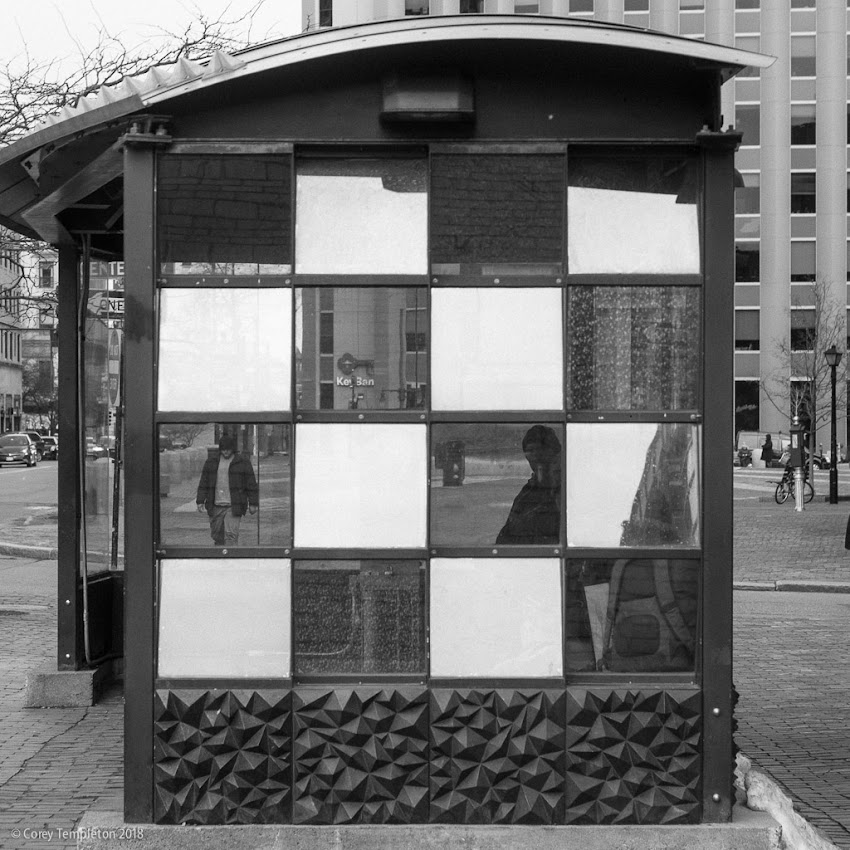 Portland, Maine USA March 2018 photo by Corey Templeton. A black and white look at the bus stop near Monument Square.
