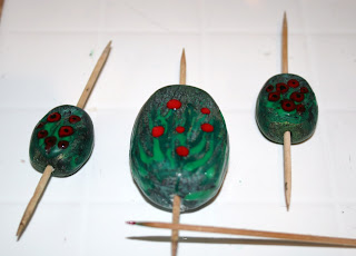 My polymer clay beads are painted with the TLS & oil paint mix