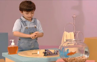 a child turns on the faucet and checks the temperature of the water before washing his hands. Sesame Street Elmo's World Hands Kids and Baby