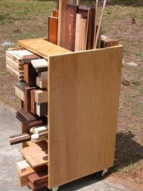 wooden rolling cart to store scrap pieces of wood.