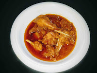 Serving Chicken curry in a serving bowl for easy chicken curry recipe