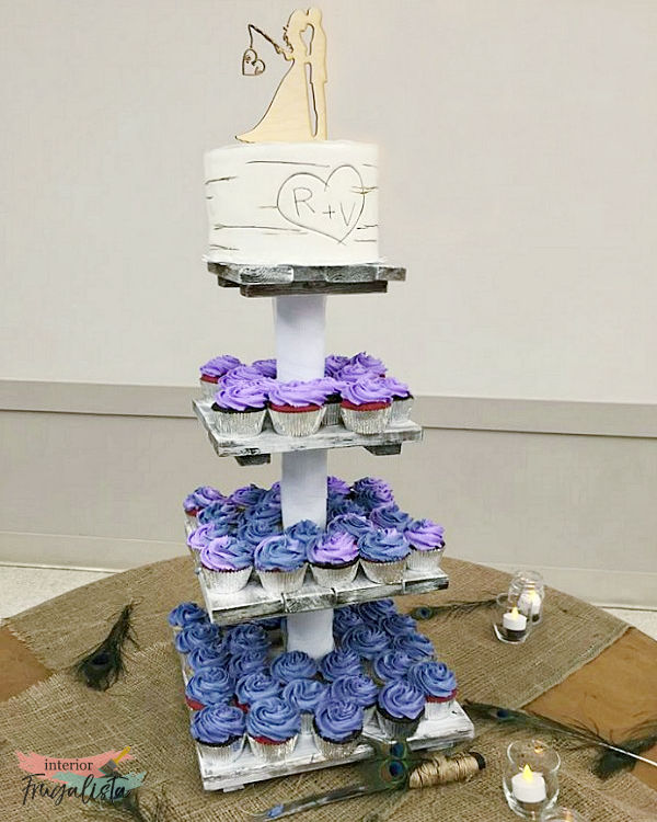 A portable DIY four-tiered rustic country wedding cupcake stand with small top tier for cake topper, easily assembled on site for destination wedding.