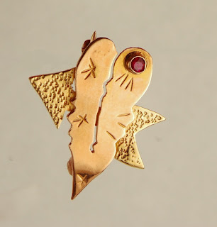 Two heart pin with red stone in pink and yellow gold