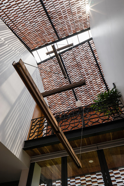 spaced out bricks on metal grid and skylight