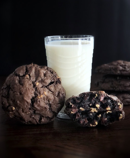 huge double chocolate peanut butter cookies with a tall glass of milk