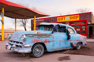 a photograph of an old chevrolet on route 66 in seligman arizona