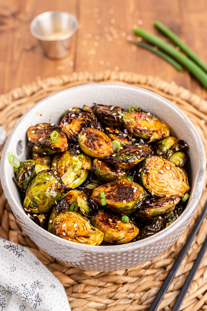 Photo of a white bowl full of Kung Pao Brussels Sprouts.