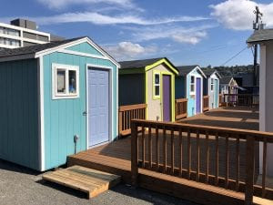 Six tiny houses share a common deck in Lake Union Village. Photo courtesy of LIHI.