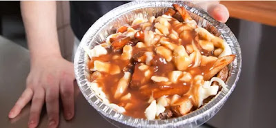 WHERE DOES POUTINE ORIGINATE FROM?