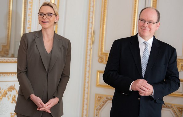 Princess Charlene wore a new wool blazer and pants by Tom Ford. Charlene wore Tom Ford wool pantsuit