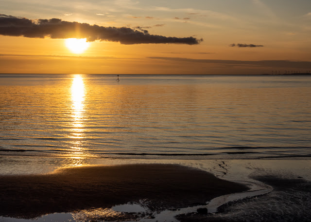 Photo of the sun setting over the Solway Firth