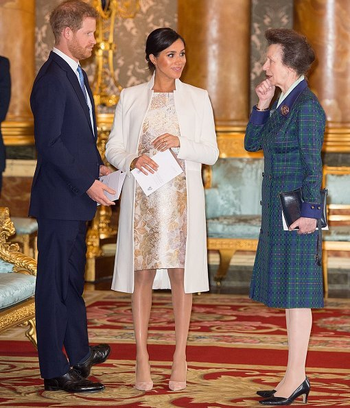 Kate Middleton is wearing a midi dress with ruffle detail