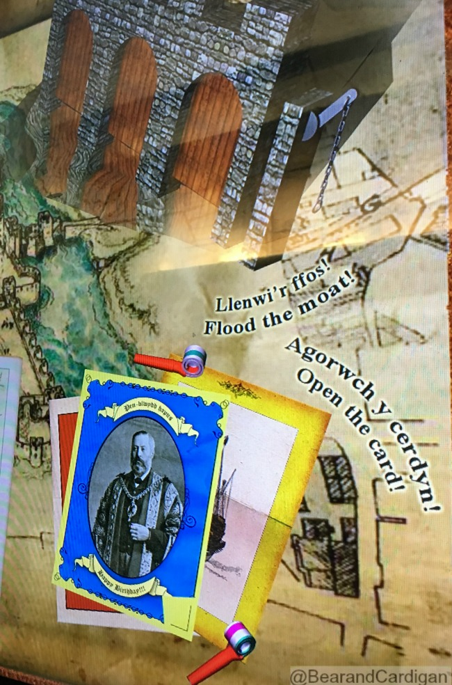 Caerphilly-Castle-board-with-flood-the-moat-and-open-the-card-sign