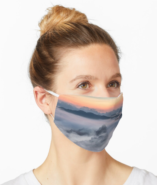 Foggy sunset over the mountains Mask | Top selling on redbubble!