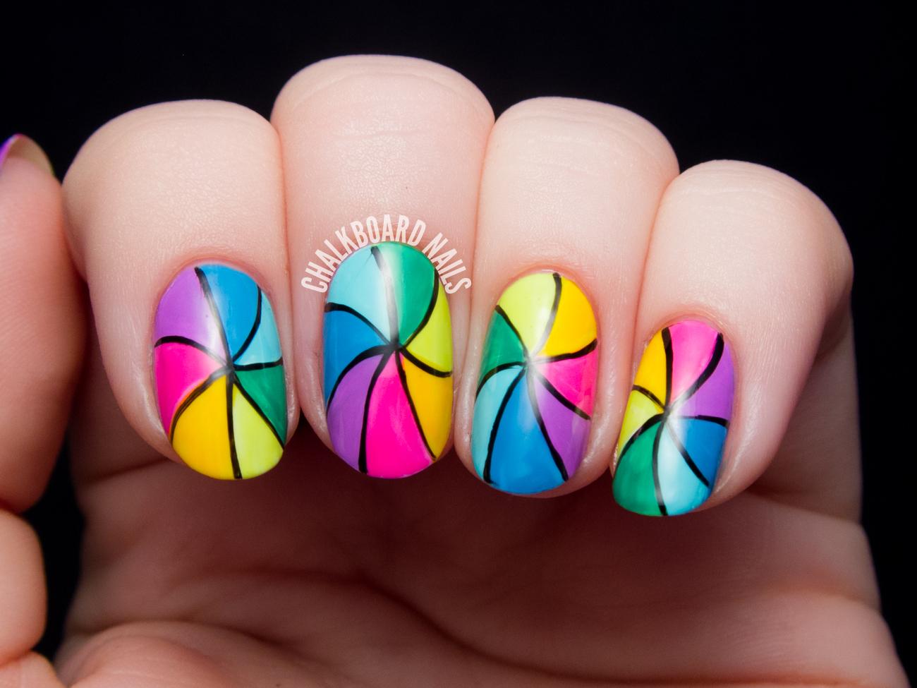 Rainbow pinwheel nail art by @chalkboardnails