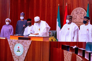 Buhari Signs 2021 Budget, Finance Bill Into Law