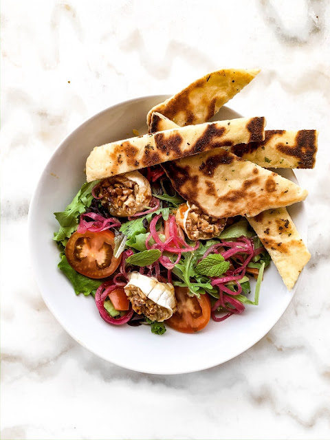 Salad with Goat cheese, pickled onion and Naan on side