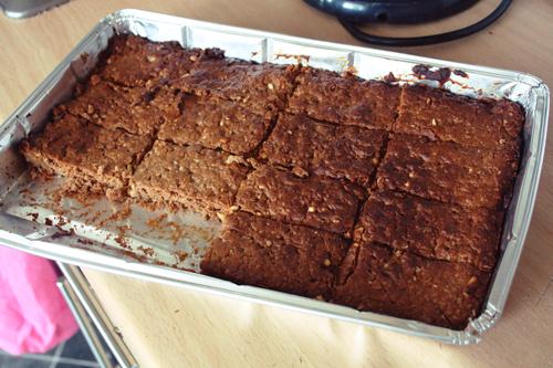peanut butter granola bars having just been cut, still in their disposable baking tray