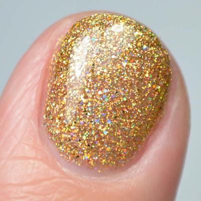 holo gold nail polish close up swatch