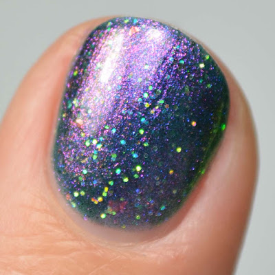 teal based multichrome nail polish swatch close up
