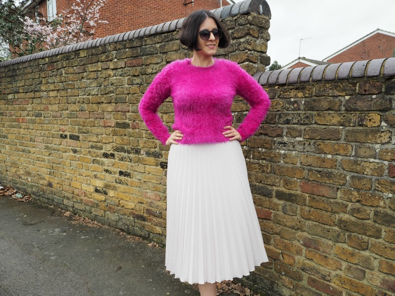 Pink fluffy jumper and blush pleated skirt