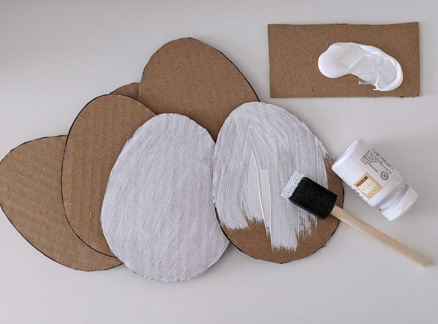 white paint on cardboard egg for Easter craft