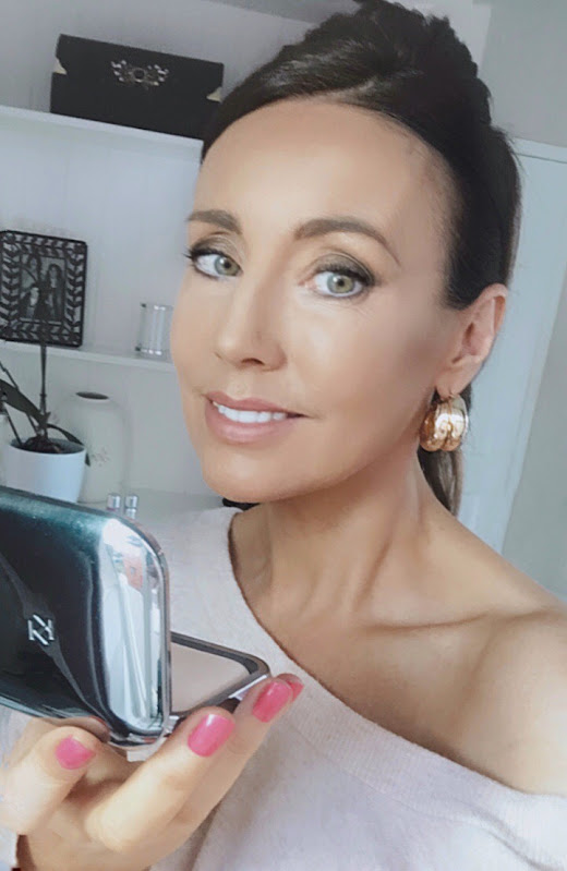 Woman using face compact