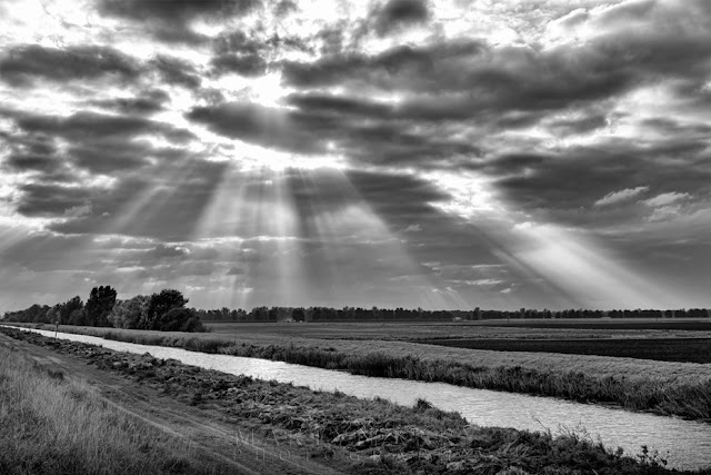 Black and white images of Ouse Washes and shafts of sunlight in Cambridgeshire