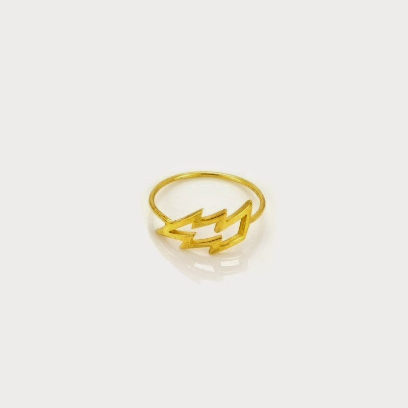 A little lightning bolt ring is by Laura Gravestock. I love that like the Missoma piece they have done something a little different from the popular pave setting. This cute cut out ring is also made out of 18 karat gold vermeil. Check out the rest of Laura''s Struck collection.