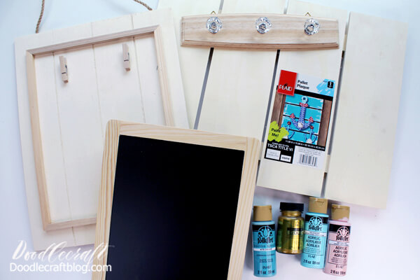 Supplies Needed for DIY Command Center: Chalkboard  Hanger with crystal knobs  Wood Pallet Plaque  Pallet Sign with Clips Folk Art Acrylic Paint (Cascade, Conch Shell and Ocean View) Treasure Gold Paint (Gold) Paintbrushes 1x2 board 21 inches long 1x1 boards 5 inches long (3) Small nails and Hammer Leather Strip (or ribbon could be used) Hook and Loop Closure Adhesive Strip Screwdriver Painters Tape Clean Soup Can Hot Glue/Gun E6000 Glue