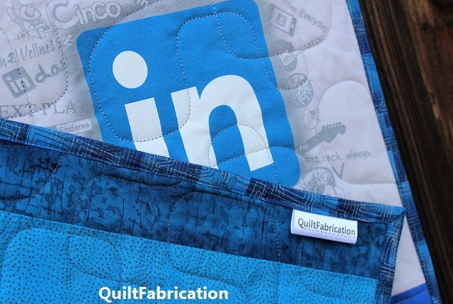 LinkedIn t-shirt quilt backing and QuiltFabrication label