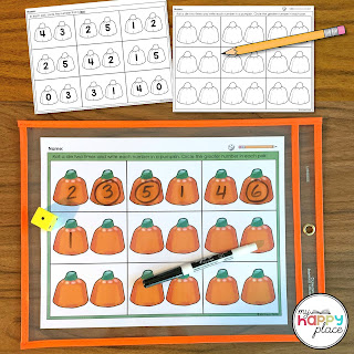 Dry erase center game for comparing numbers