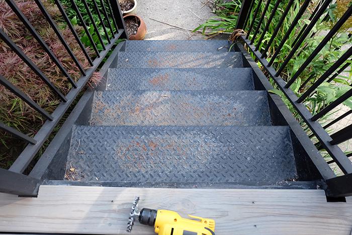rusting metal stair steps before