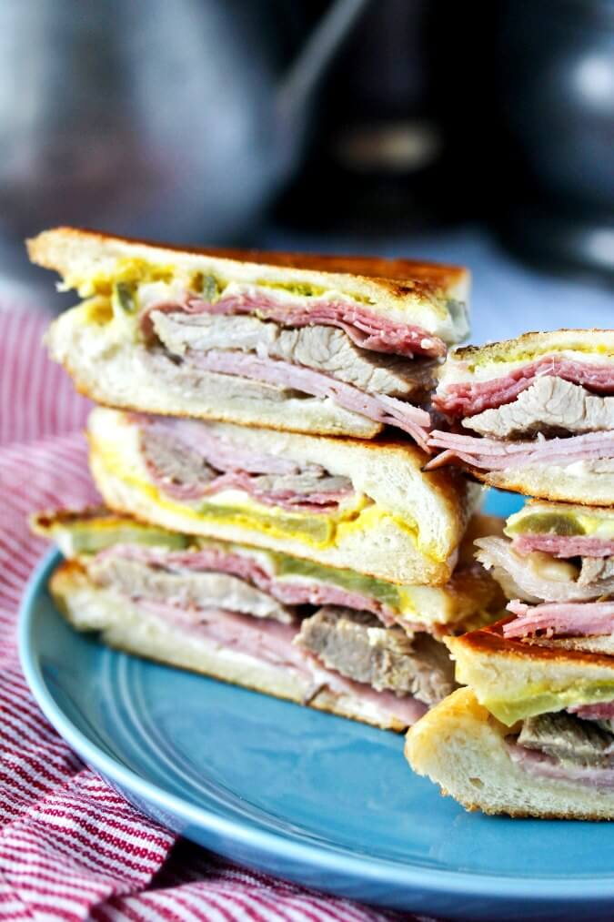 The Cuban Sandwich (The Cubano) stacked and sliced