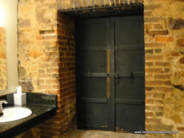 mine tunnel doors in women's restroom at The Holbrooke hotel in Grass Valley, California