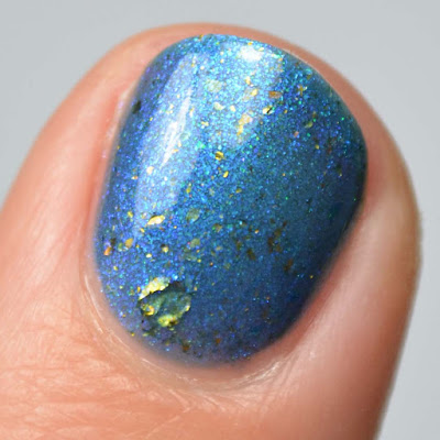 smoky blue nail polish with color shifting flakies swatch