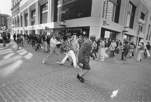 Photo of attorney Ted Landsmark, accosted by several protesters in a Boston courtyard. Photograph by Stanley Forman. Part of The Soiling of Old Glory, an award winning photo taken  in 1976