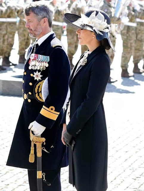 Crown Princess Mary wore a cappotto black coat by Prada, and printed silk dress by MaxMara. Jimmy Choo Billie pumps