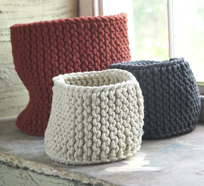 three hand-knitted rope baskets