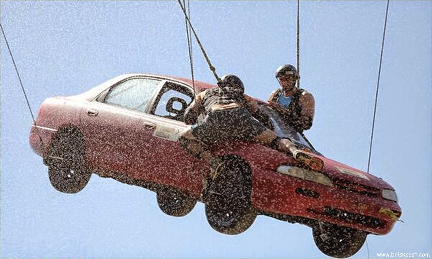Fear Factor Khatron Ke Khiladi 5 contestant Daya and Nikitin on hanging car on height in water shower during a stunt