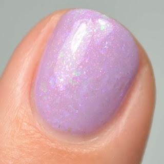 purple nail polish with flakies