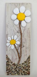 pannello fiori con riciclo pietre