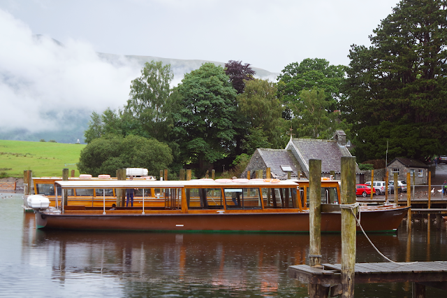 wooden boat moored in the rain at derwent water