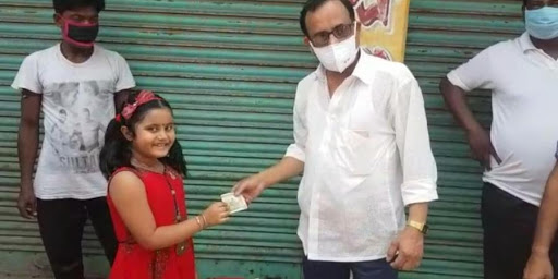 child donating money