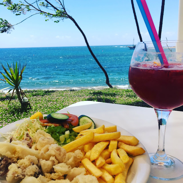 Food and drink on table with sea view at Bona Mare, Timi, Cyprus